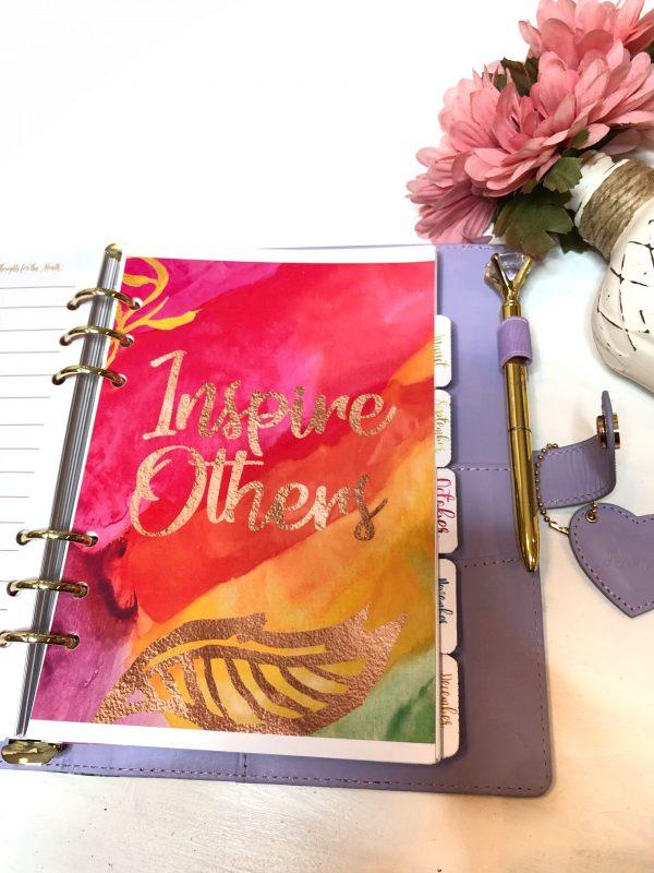Gold scripture pen in planner