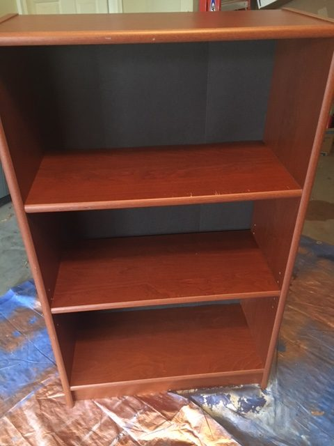plain brown book case before photo